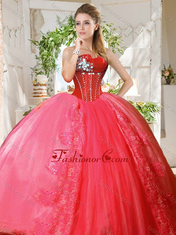 Romantic puffy skirt beaded and applique quinceanera dress in coral