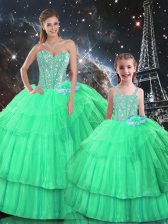 Sleeveless Organza Floor Length Lace Up Quince Ball Gowns in Apple Green with Ruffled Layers