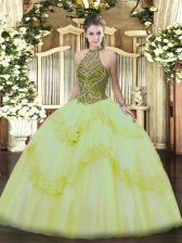 Light Yellow Halter Top Neckline Beading and Appliques Sweet 16 Dresses Sleeveless Lace Up