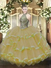 Gold Halter Top Neckline Beading and Ruffles Quinceanera Gown Sleeveless Lace Up