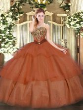 Sleeveless Tulle Floor Length Lace Up Quinceanera Gown in Rust Red with Beading and Ruffled Layers
