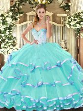 Latest Sleeveless Organza Floor Length Lace Up Sweet 16 Dress in Turquoise with Beading and Ruffled Layers